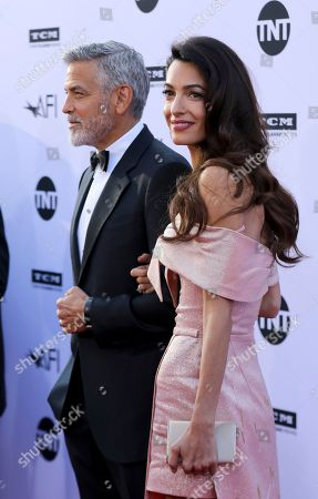 George Clooney, Amal Clooney. Amal Clooney, right, and George Clooney arrive at the 46th AFI Life Achievement Award Honoring George Clooney at the Dolby Theatre, in Los Angeles
