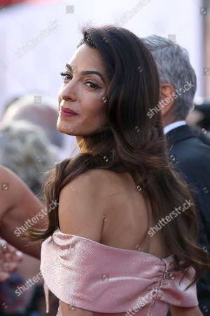 Amal Clooney arrives at the 46th AFI Life Achievement Award Honoring George Clooney at the Dolby Theatre, in Los Angeles