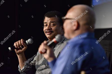 Stock Photo of Larry Wilmore, Neil deGrasse Tyson