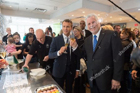 Stock Photo of Emmanuel Macron and Philippe Couillard drinking.