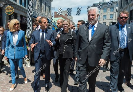 Prime Minister of Quebec Philippe Couillard and his wife and French President Emmanuel Macron and his wife Brigitte Trogneux walking in old city of Montreal.