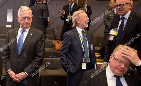 Stock Photo of U.S. Secretary for Defense Jim Mattis, left, and Swedish Defense Minister Peter Hultqvist, right, wait for the start of a round table meeting of NATO defense ministers at NATO headquarters in Brussels