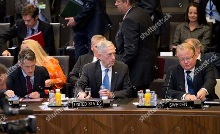 Stock Image of U.S. Secretary for Defense Jim Mattis, center, Swedish Defense Minister Peter Hultqvist, right, and British Defense Minister Gavin Williamson, left, attend a round table meeting of NATO defense ministers at NATO headquarters in Brussels