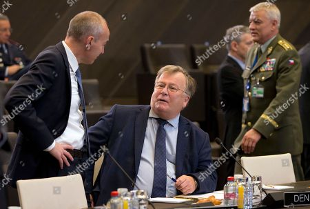 Stock Picture of Croatian Defense Minister Damir Krsticevic, left, speaks with Danish Defense Minister Claus Hjort Frederiksen, center, during a round table meeting of NATO defense ministers at NATO headquarters in Brussels
