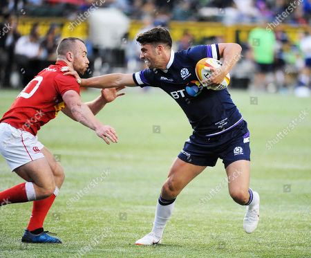 Adam Hastings - Scotland fly half hands off opposite number Shane O?Leary (L). Canada v Scotland, Commonwealth Stadium, Edmonton, Canada, Saturday 9th June May 2018 ***Please credit: ©Fotosport/David Gibson***