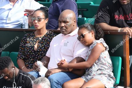 Mike Tyson with his wife Kiki Spicer and their daughter Milan Tyson