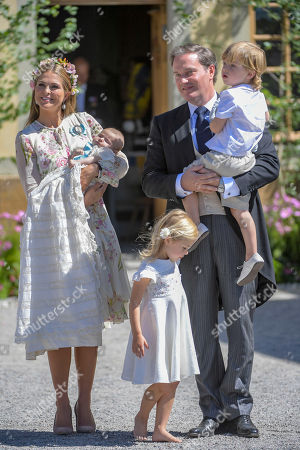 Princess Madeleine, princess Adrienne princess Leonore, Mr Christopher O'Neill and prince Nicolas after the princess Adrienne's christening ceremony  in Drottningholm Palace Chapel outside Stockholm, 08 June 2018. Princess Adrienne is princess Madeleine's and Mr Christopher O'Neill's third child.