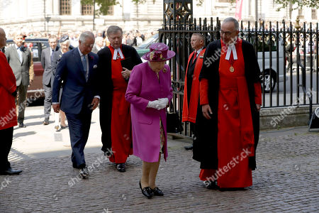 "Britain's Queen Elizabeth II, accompanied by Prince Charles, background left, walks with the Dean of Westminster Abbey Dr John Hall, right, as she arrives to open ""The Queen's Diamond Jubilee Galleries"" in Westminster Abbey, London, . The Queen's Diamond Jubilee Galleries will open to the public on June 11. The new galleries are set more than 16 metres above the Abbey's floor in the medieval Triforium, an area that has never been open to the public before"
