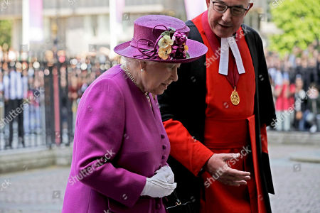 "Britain's Queen Elizabeth II walks with the Dean of Westminster Abbey Dr John Hall, as she arrives to open ""The Queen's Diamond Jubilee Galleries"" in Westminster Abbey, London, . The Queen's Diamond Jubilee Galleries will open to the public on June 11. The new galleries are set more than 16 metres above the Abbey's floor in the medieval Triforium, an area that has never been open to the public before"
