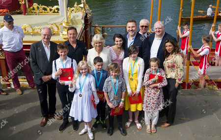 Camilla Duchess of Cornwall poses for a photograph alonside Gloriana, the Queens Rowbarge with celebrities including Jim Broadbent, Jason Isaacs, Amanda Abbington, David Walliams, Chris Evans, Dara O' Briain, Shobna Gulati and the six winning children at the live broadcast of the final of BBC Radio 2's 500 Words creative writing competition at Hampton Court Palace
