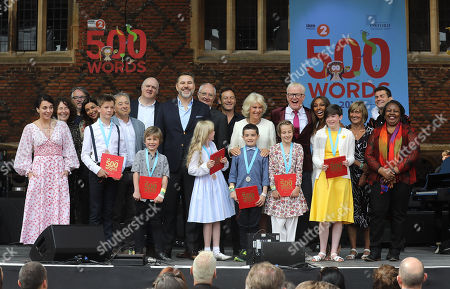 Camilla Duchess of Cornwall poses for a photograph with celebrities including Amanda Abbington, Shobna Gulati, Dara O' Briain, David Walliams, Jim Broadbent, Jason Issacs, Chris Evans and the six winning children at the live broadcast of the final of BBC Radio 2's 500 Words creative writing competition at Hampton Court Palace