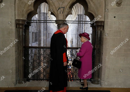 Britain's Queen Elizabeth II, is shown the view from The Queen's Diamond Jubilee Galleries by The Dean of Westminster Abbey, The Very Reverend Dr. John Hall at Westminster Abbey in London, . The Queen's Diamond Jubilee Galleries will open to the public on June 11. The new galleries are set more than 16 metres above the Abbey's floor in the medieval Triforium, an area that has never been open to the public before
