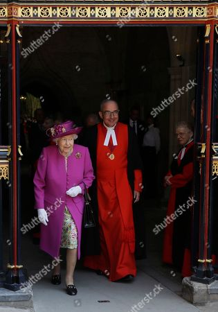 Stock Picture of Britain's Queen Elizabeth II, accompanied by The Dean of Westminster Abbey, The Very Reverend Dr. John Hall leaves after opening The Queen's Diamond Jubilee Galleries at Westminster Abbey in London, . The Queen's Diamond Jubilee Galleries will open to the public on June 11. The new galleries are set more than 16 metres above the Abbey's floor in the medieval Triforium, an area that has never been open to the public before