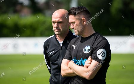 Danny Murphy and Robbie Keane during training at Motspur Park training ground with World XI