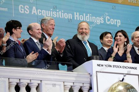 David Cote, Stacey Cunningham. GS Acquisition Holdings Corp. CEO David Cote, center, is applauded as he rings the opening bell of the New York Stock Exchange, . Joining the ceremony marking his company's IPO, is NYSE President Stacey Cunningham, right