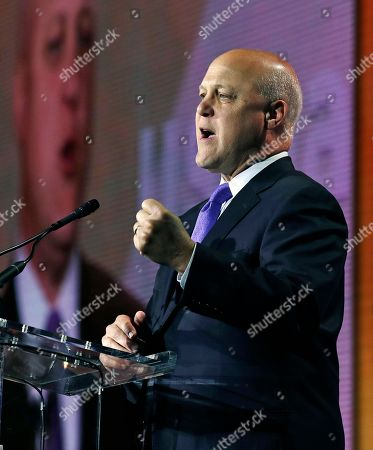 Former New Orleans Mayor Mitch Landrieu gestures as he addresses a luncheon during the annual meeting of the U.S. Conference of Mayors in Boston, . More than 250 city executives gathered to discuss their concerns including infrastructure, school safety, immigration and the economic future of cities
