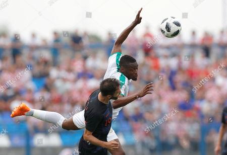 Croatia's Milan Badelj, front, is challenged by Senegal's Diafra Sakho during a friendly soccer match between Croatia and Senegal in Osijek, Croatia