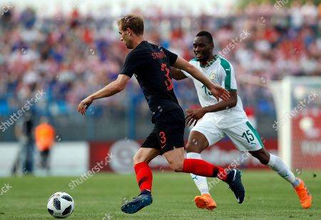 Croatia's Ivan Strinic, left, is challenged by Senegal's Diafra Sakho during a friendly soccer match between Croatia and Senegal in Osijek, Croatia