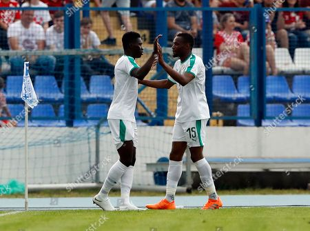 Senegal's Ismaila Sarr, left, celebrates with Senegal's Diafra Sakho after scoring his side's opening goal during a friendly soccer match between Croatia and Senegal in Osijek, Croatia