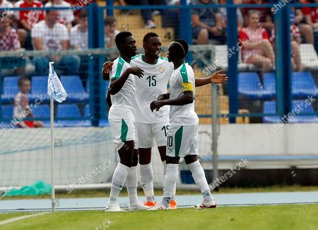Senegal's Ismaila Sarr, left, celebrates with Senegal's Diafra Sakho, center and Senegal's Sadio Mane, right, after scoring his side's opening goal during a friendly soccer match between Croatia and Senegal in Osijek, Croatia