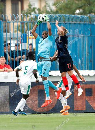 Senegal's goalkeeper Abdoulaye Diallo (L) in action against Croatia's Domagoj Vida (R) during the International friendly soccer match between Croatia and Senegal in Osijek, Croatia, 08 June 2018.