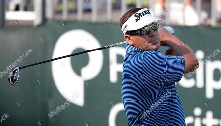 Mark Calcavecchia hits off the first tee during the first round of the PGA Tour Champions Principal Charity Classic golf tournament, in Des Moines, Iowa