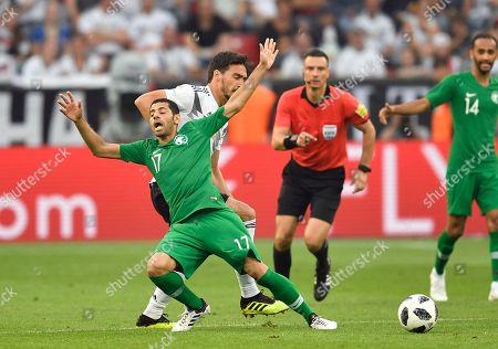 Saudi Arabia's Taisir Al-Jassim, front left, duels for the ball with Germany's Mats Hummels during a friendly soccer match between Germany and Saudi Arabia at BayArena in Leverkusen, Germany