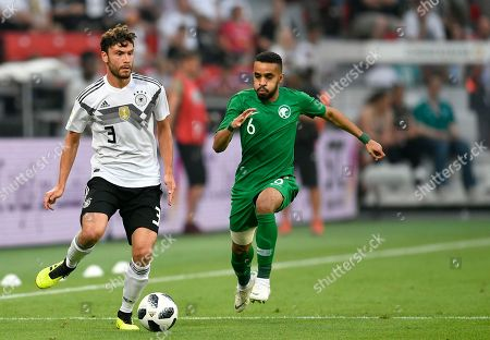 Germany's Jonas Hector, left, and Saudi Arabia's Mohammed Al-Breik run for the ball during a friendly soccer match between Germany and Saudi Arabia at BayArena in Leverkusen, Germany
