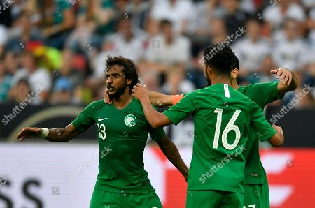 Saudi Arabia's Taisir Al-Jassim, right, celebrates with teammates after scoring his side's opening goal during a friendly soccer match between Germany and Saudi Arabia at BayArena in Leverkusen, Germany
