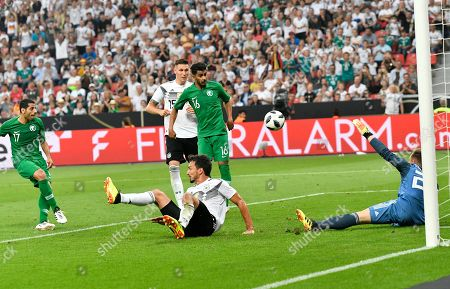 Saudi Arabia's Taisir Al-Jassim, left, scores his side's opening goal during a friendly soccer match between Germany and Saudi Arabia at BayArena in Leverkusen, Germany