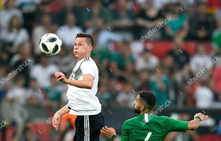 Germany's Julian Draxler, left, duels for the ball with Saudi Arabia's Mohammed Al-Breik during a friendly soccer match between Germany and Saudi Arabia at BayArena in Leverkusen, Germany