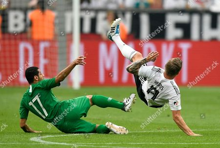 Germany's Toni Kroos, right, duels for the ball with Saudi Arabia's Taisir Al-Jassim during a friendly soccer match between Germany and Saudi Arabia at BayArena in Leverkusen, Germany