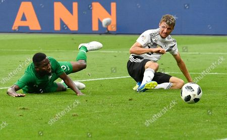 Saudi Arabia's Omar Hawsawi, left, scores own goal by Germany's Thomas Muller during a friendly soccer match between Germany and Saudi Arabia at BayArena in Leverkusen, Germany