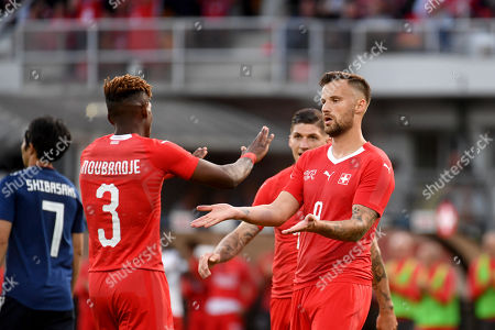 Switzerland's Jacques Francois Moubandje (L) and Switzerland's Haris Seferovic celebrate during the international friendly soccer match between Switzerland and Japan at the Cornaredo stadium in Lugano, Switzerland, 08 June 2018.