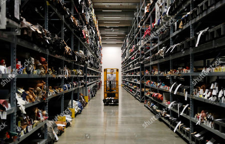 Stock Photo of Items are lined up on shelves at Prada's new industrial headquarters and production site, in Valvigna, Italy, . Prada CEO Patrizio Bertelli said Friday that the family-controlled Italian fashion group has no intention of selling and that his elder son with co-CEO and creative director Miuccia Prada is being groomed to take over