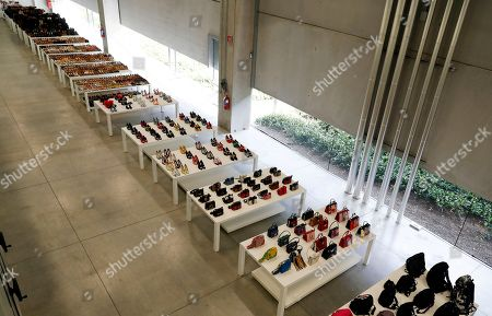 Shoes and bags are lined up at Prada's new industrial headquarters and production site, in Valvigna, Italy, . Prada CEO Patrizio Bertelli said Friday that the family-controlled Italian fashion group has no intention of selling and that his elder son with co-CEO and creative director Miuccia Prada is being groomed to take over