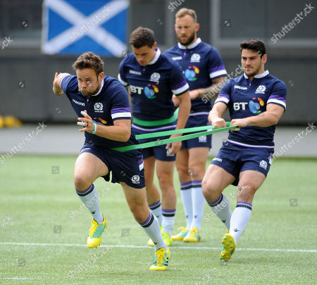 Ruaridh Jackson - Scotland fly half takes off during explosive sprint training with the help of Sam Hidalgo-Clyne (R). 