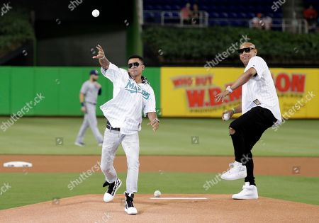 Randy Malcolm, Alexander Delgado. Randy Malcolm, left, and Alexander Delgado, right, of the band Gente de Zona, throw a ceremonial pitch before a baseball game between the Miami Marlins and San Diego Padres, in Miami