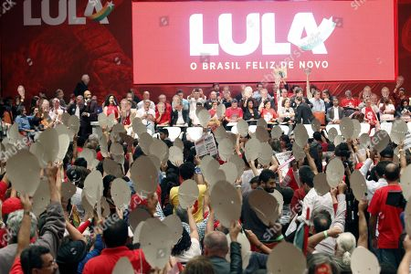Supporters of Luis Inacio Lula da Silva participate in the Partido de los Trabajadores (PT) national launch of the pre-candidacy for Presidency of Luiz Inacio Lula da Silva in Contagem, Minas Gerais, Brazil, 8 June 2018. Although he leads all polls of intention to vote for the presidential, Lula is currently serving a sentence of 12 years in prison for corruption and is disqualified electorally for having been convicted by a collegiate court in second instance.