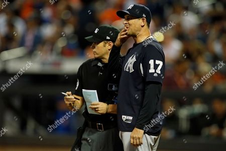 Aaron Boone, Mark Wegner. New York Yankees manager Aaron Boone talks with home plate umpire Mark Wegner during the sixth inning of a baseball game against the New York Mets, in New York