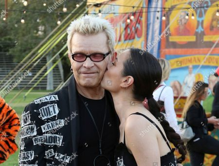 Billy Idol, China Chow. China Chow, right, kisses Billy Idol at the MOSCHINO Spring/Summer 2019 Menswear Resort Womenswear Show and Party, in Burbank, Calif