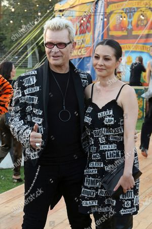 Billy Idol, China Chow. Billy Idol, left, and China Chow attend the MOSCHINO Spring/Summer 2019 Menswear Resort Womenswear Show and Party, in Burbank, Calif