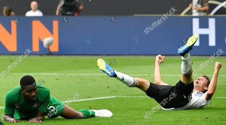 Germany's Thomas Mueller, right, reacts beside Saudi Arabia's Omar Hawsawi during a friendly soccer match between Germany and Saudi Arabia at BayArena in Leverkusen, Germany