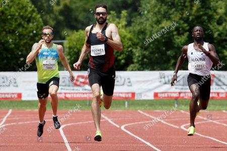 Joel Burgunder, (L), of Switzerland, Martyn Rooney, (C), of England, Miloud Laredj, (R), of Algeria, compete at the men's 400 meters, during the AtletiCAGeneve athletics meeting - Swiss meeting, in Geneva, Switzerland, 09 June 2018.