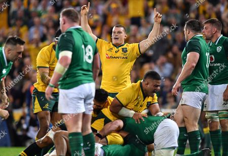 Stock Image of Tom Robertson (centre) of the Wallabies celebrates after his teammate David Pocock (not pictured) of the Wallabies scored the winning try during the First Test between Australia and Ireland at Suncorp Stadium in Brisbane, Saturday, June 9, 2018.