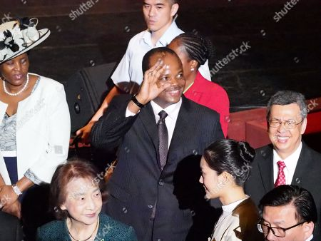 Stock Picture of King Mswati III (C) of Swatini, formerly known as Swaziland, flanked by Queen LaMotsa (L) and Taiwan's Vice President Chen Chien-jen (R), waves to students while attending the graduation ceremony of his son, Prince Buhlebenkhosi from the Shih Chien University, in Taipei, Taiwan, 09 June 2018. The King also received an honorary doctorate degree from the Shih Chien Univesrity. During his speech, King Mswati III said 'The nation of eSwatini will remain friends with Taiwan for generations.' The Kingdom of eSwatini is one of the 12 countries recognizing Taiwan and is Taiwan's only African ally after Burkina Faso dropped Taipei to recognize Beijing in May. Chinese Foreign Minister Wang Yi also in May called on eSwatini to launch diplomatic ties with China before Beijing hosts a summit of African leaders in early September.