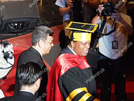 King Mswati III (R) of Swatini, formerly known as Swaziland, accompanied by Taiwan's Vice President Chen Chien-jen (L), waves to students while attending the graduation ceremony of his son, Prince Buhlebenkhosi from the Shih Chien University, in Taipei, Taiwan, 09 June 2018. The King also received an honorary doctorate degree from the Shih Chien Univesrity. During his speech, King Mswati III said 'The nation of eSwatini will remain friends with Taiwan for generations.' The Kingdom of eSwatini is one of the 12 countries recognizing Taiwan and is Taiwan's only African ally after Burkina Faso dropped Taipei to recognize Beijing in May. Chinese Foreign Minister Wang Yi also in May called on eSwatini to launch diplomatic ties with China before Beijing hosts a summit of African leaders in early September.