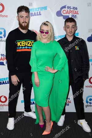 Jack Patterson, Grace Chatto and Luke Patterson, Clean Bandit. From left, Jack Patterson, Grace Chatto and Luke Patterson of Clean Bandit pose for photographers upon arrival at the Capital FM Summertime Ball, in London