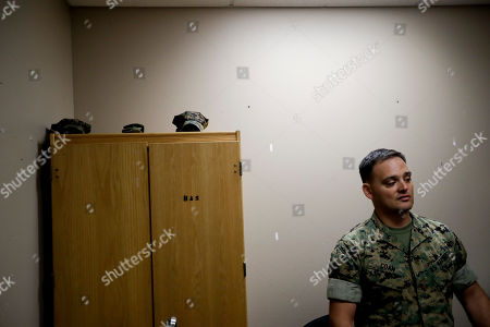 In this image, Marine Chief Warrant Officer David Coan, 35, looks out from his desk in Camp Pendleton, Calif. Coan has applied to be a part of a new cyber force after serving 17 years in the Marine Corps. The Marine Corps is considering offering bonuses to woo older, more experienced Marines to re-enlist and join its cyber operations to defend the nation, especially against cyberattacks from Russia and China