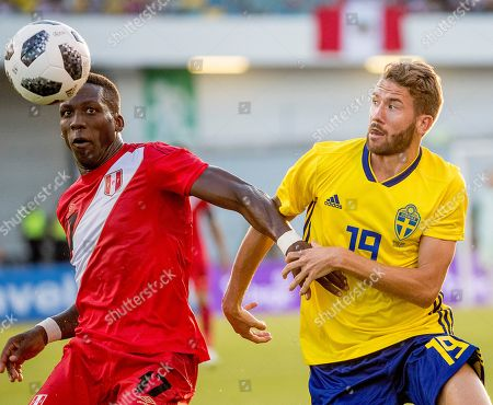 Peru's Luis Advincula (L) vies with Sweden's Marcus Rohden during the international friendly soccer match between Sweden and Peru at the Ullevi stadium in Gothenburg, Sweden, 09 June 2018.